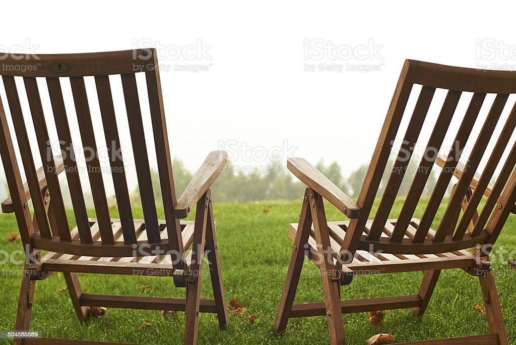 Two empty deck chairs from behind. royalty-free stock photo