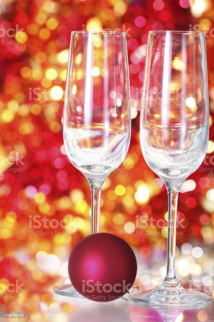 Two empty glasses and red ball decoration stock photo