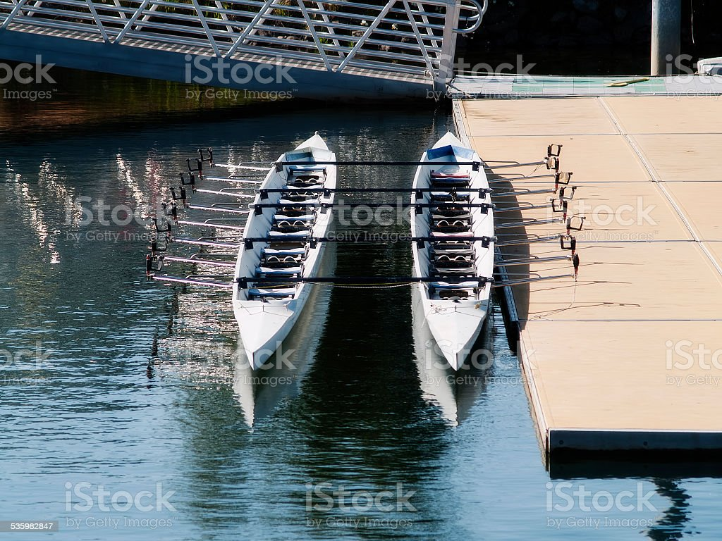 Two Empty Rowing Shells Sitting At Dock Side stock photo