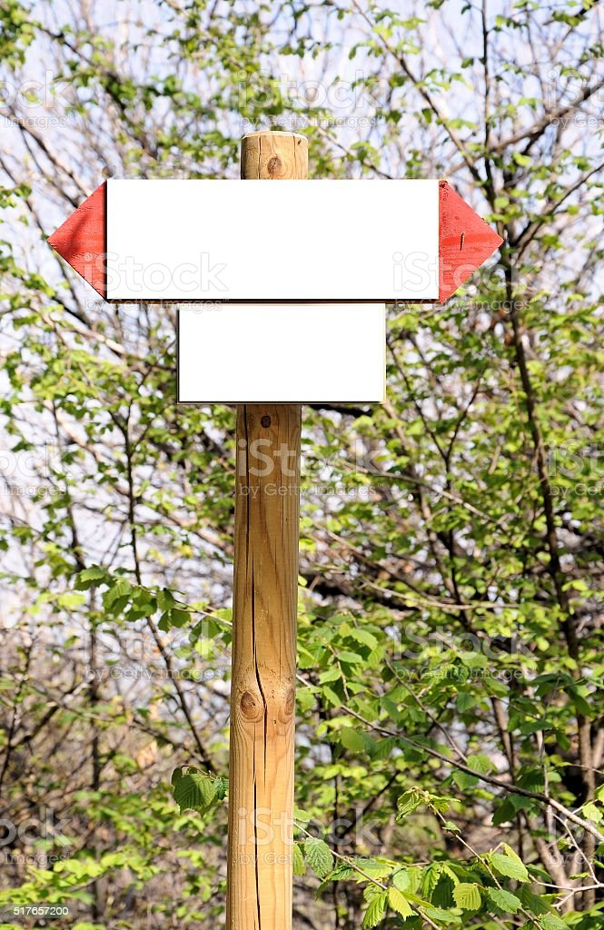 Two empty wooden signs indicators on vegetation stock photo