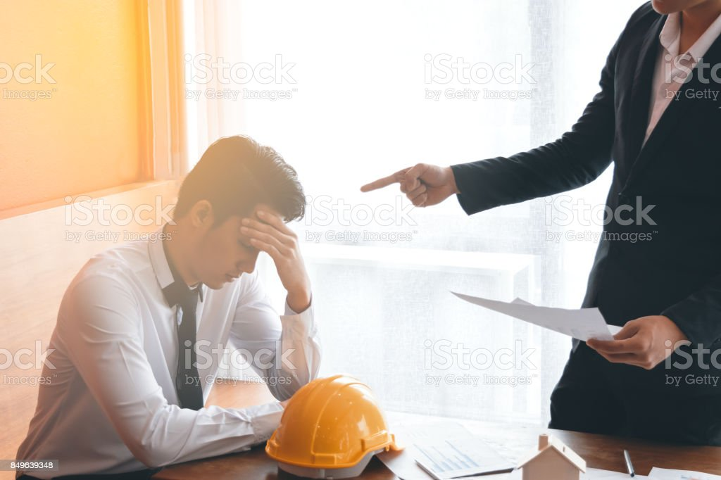 Two engineer or businessman complain the Mistake stock photo