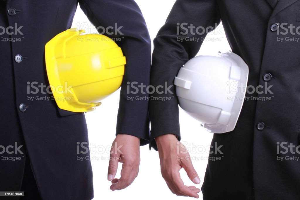 Two Engineer people holding safety hat royalty-free stock photo