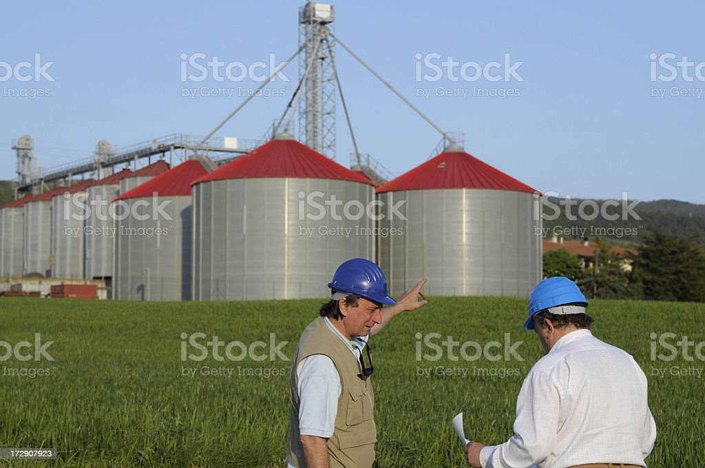 Two Engineers and New Grain Silos royalty-free stock photo