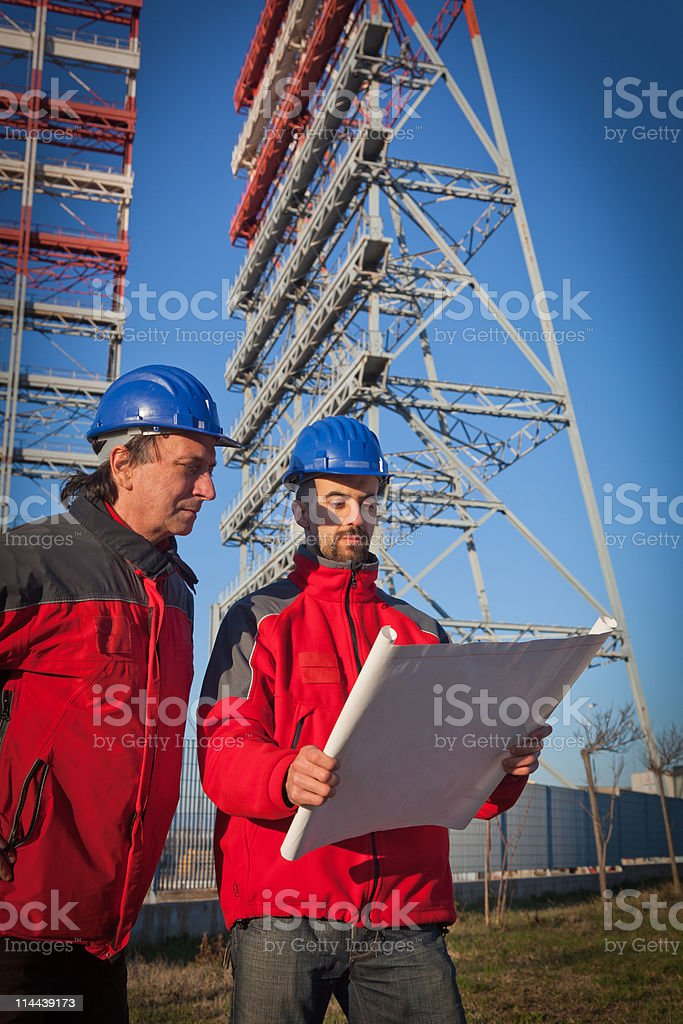Two Engineers at Work in a Construction Site royalty-free stock photo