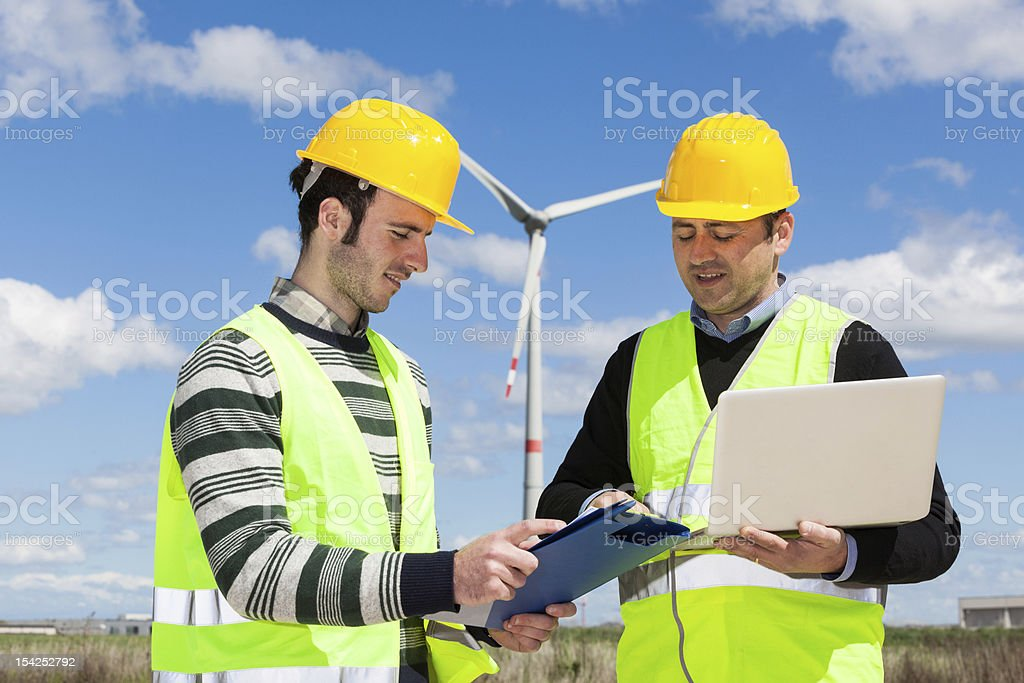 Two Engineers at Work in Wind Turbine Power Station royalty-free stock photo