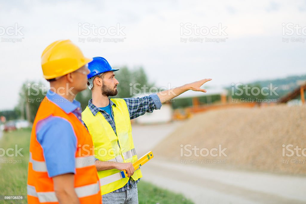 Two engineers discussing coal mine and machinery performance stock photo