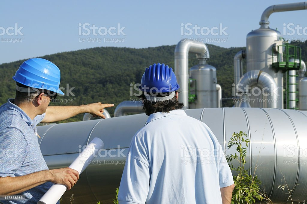 Two Engineers Planning in a Geothermal Power Station royalty-free stock photo