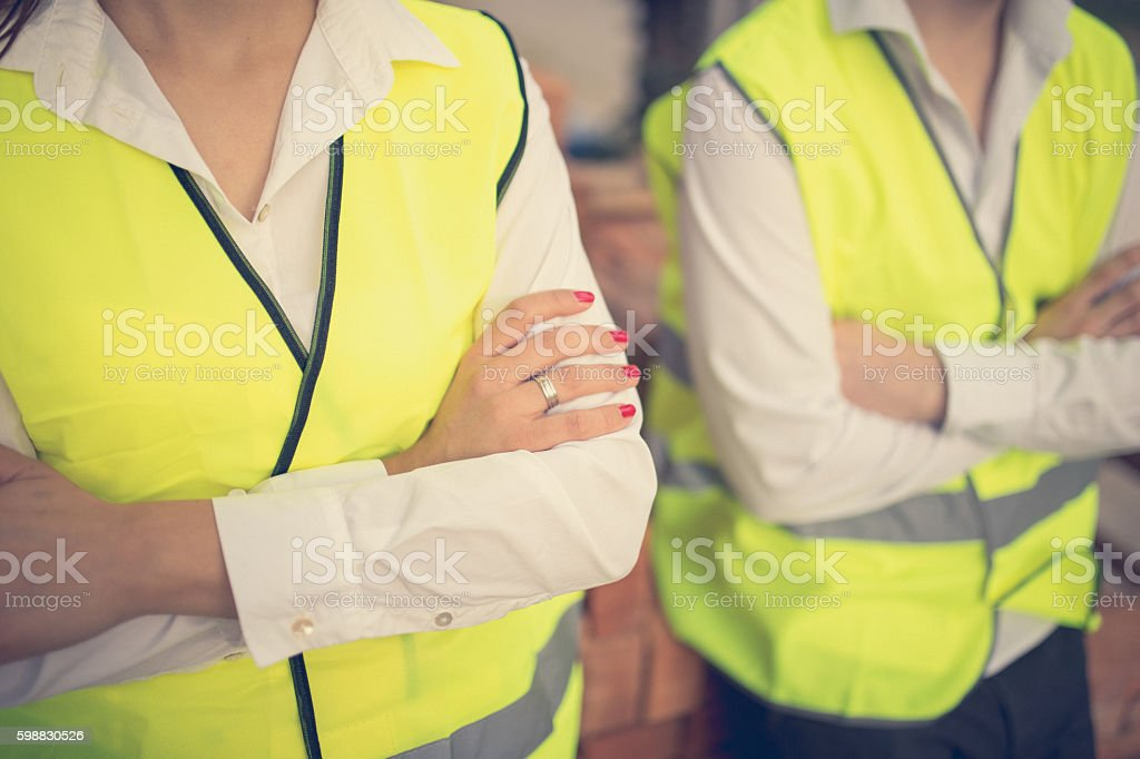 Two Engineers with crossed arms stock photo