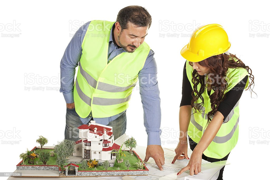 Two engineers working on plan document royalty-free stock photo