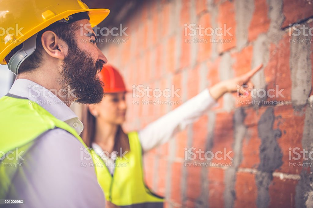 Two engineers working outdoors stock photo