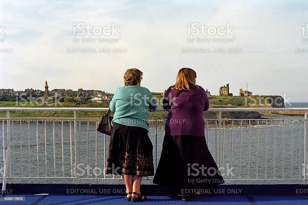 Two English tourists leaving England stock photo