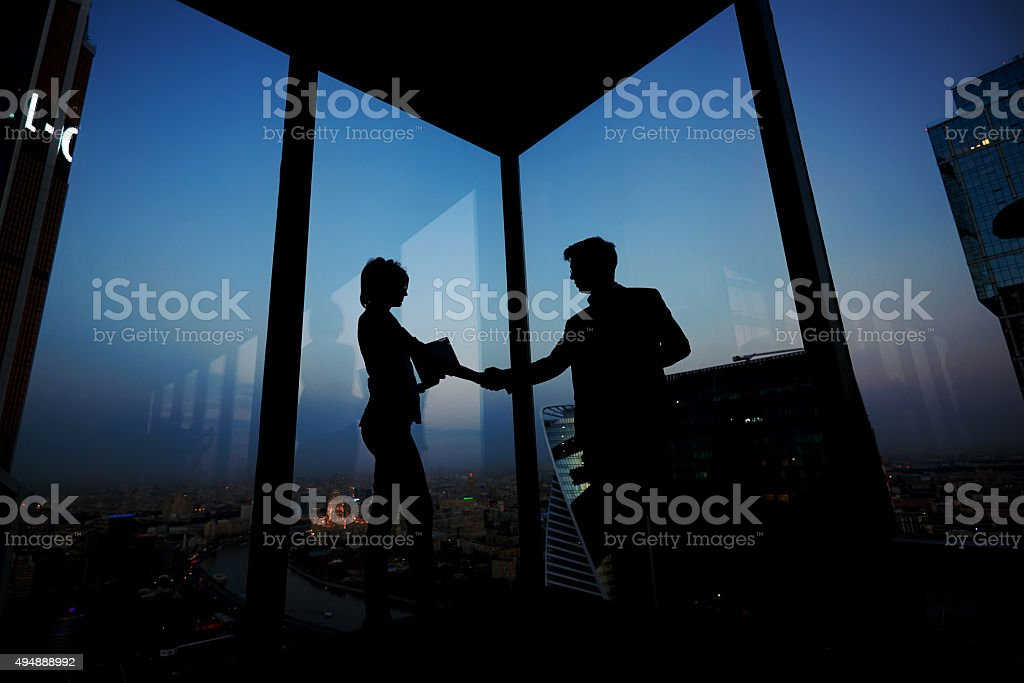 Two entrepreneurs congratulate each other with their successful work stock photo