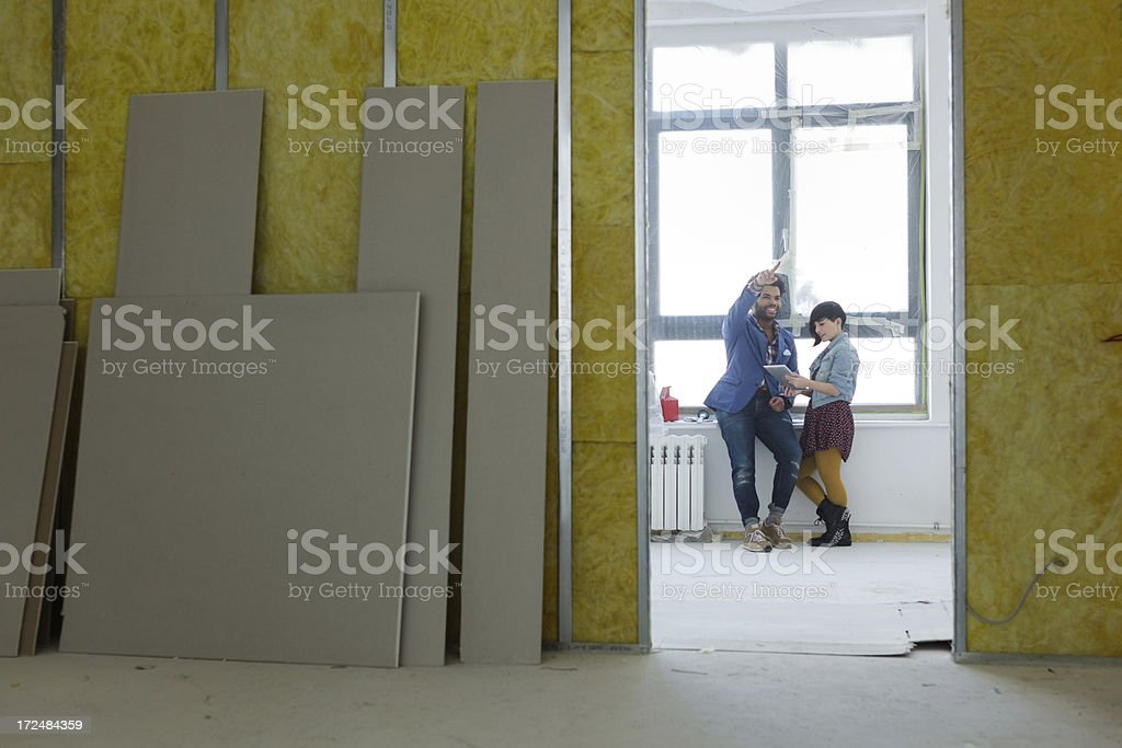 Two entrepreneurs standing in new Office space royalty-free stock photo