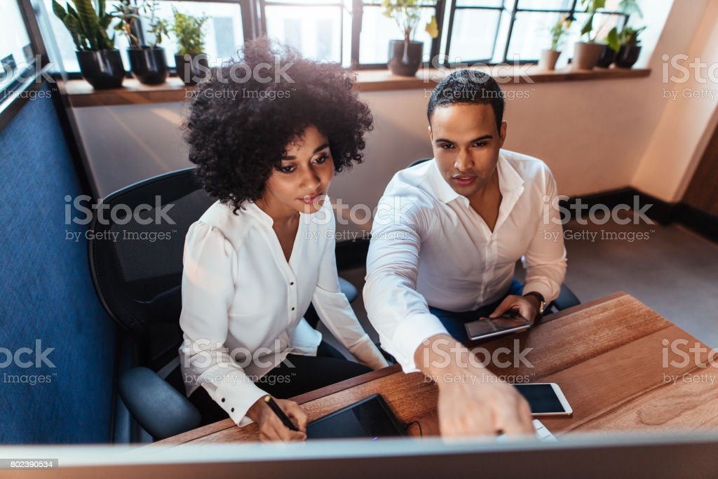 Two entrepreneurs  working in office stock photo