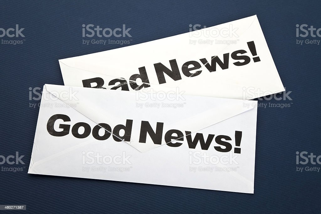 Two envelopes containing good and bad news stock photo