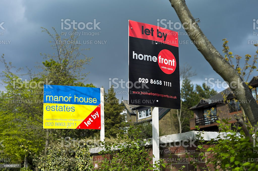 Two estate agents' lettings signs stock photo