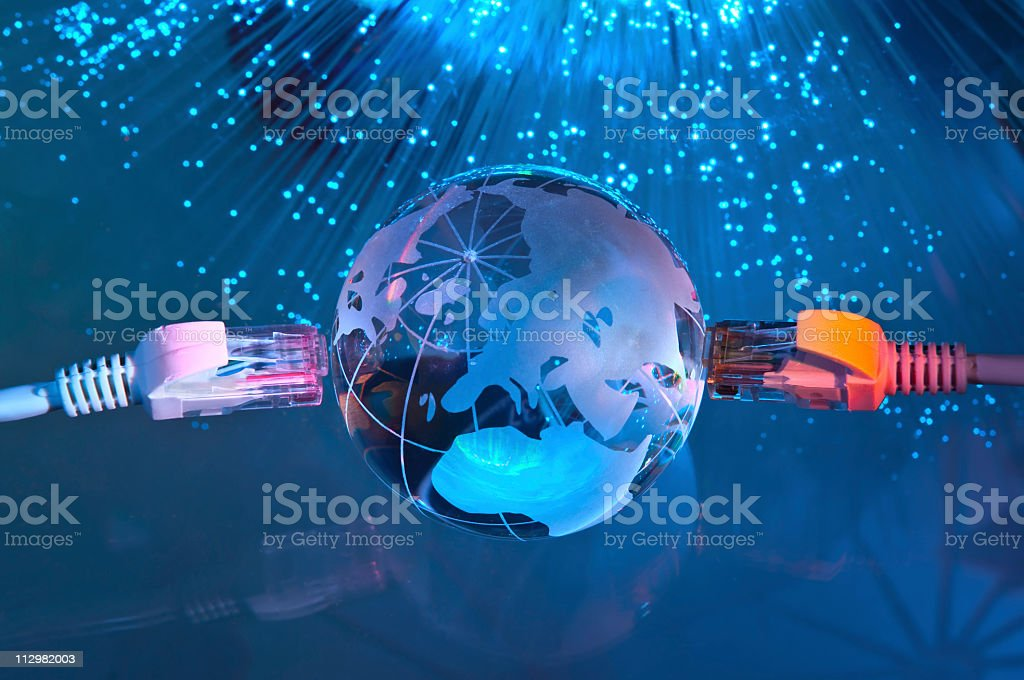 Two Ethernet cables on world signaling global communication stock photo