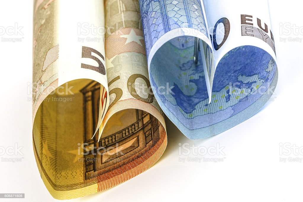 Two euro bill in the form of a heart royalty-free stock photo