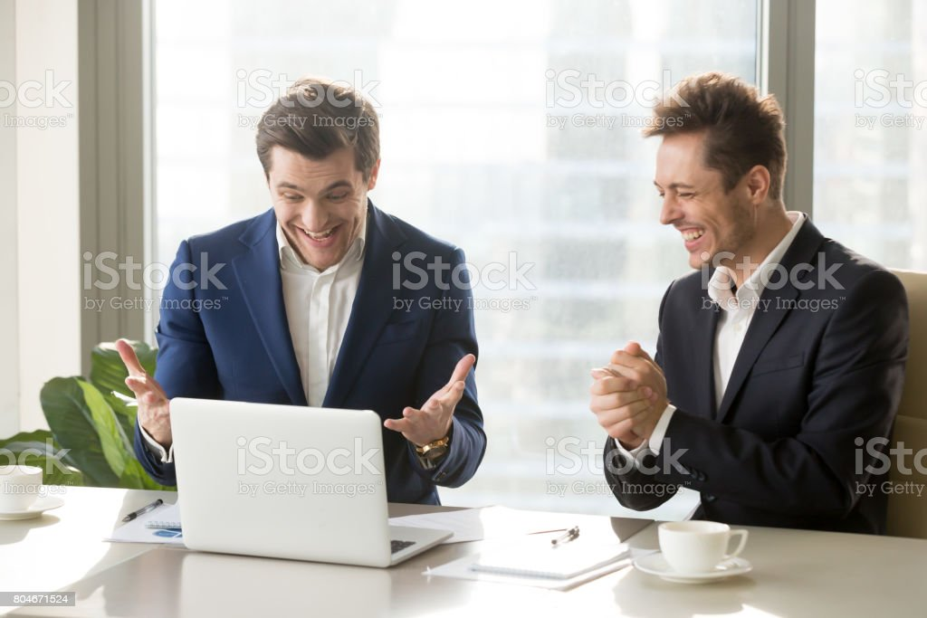 Two excited businessmen celebrating victory, won profitable contract,...