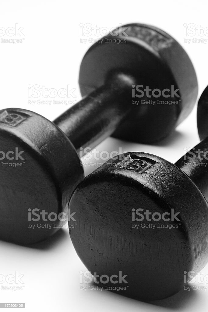 'Two exercise hand weights, dumbbells, against white background' stock photo