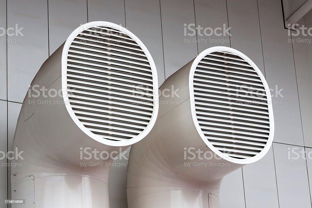 Two external ventilation pipes on office building wall royalty-free stock photo