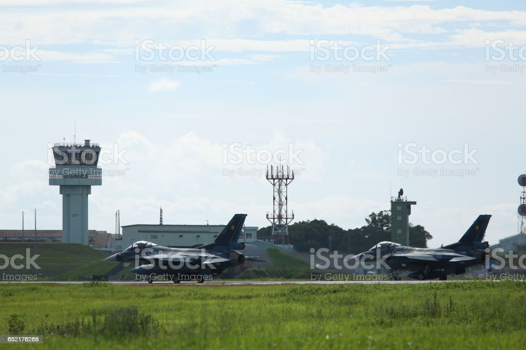 Two F-2 fighter of the Japan Air Self-Defense Force before takeoff. stock photo