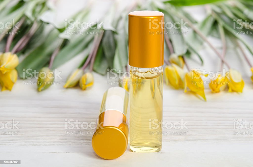 Two face serum bottles on wooden table stock photo