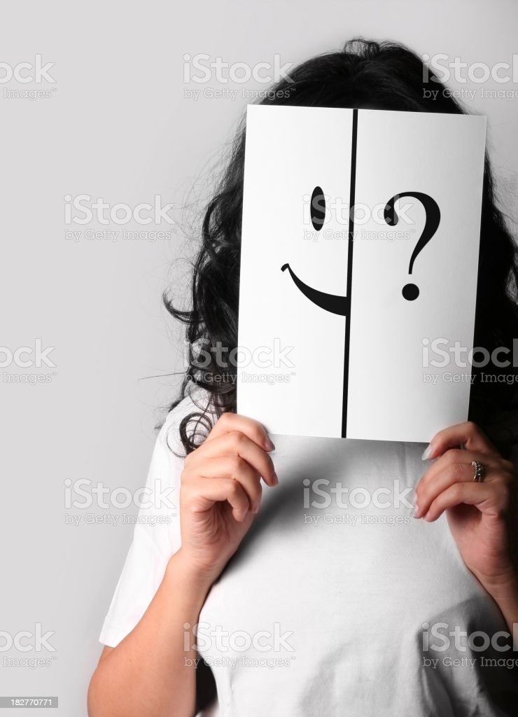 two faced.. hiding real emotion stock photo