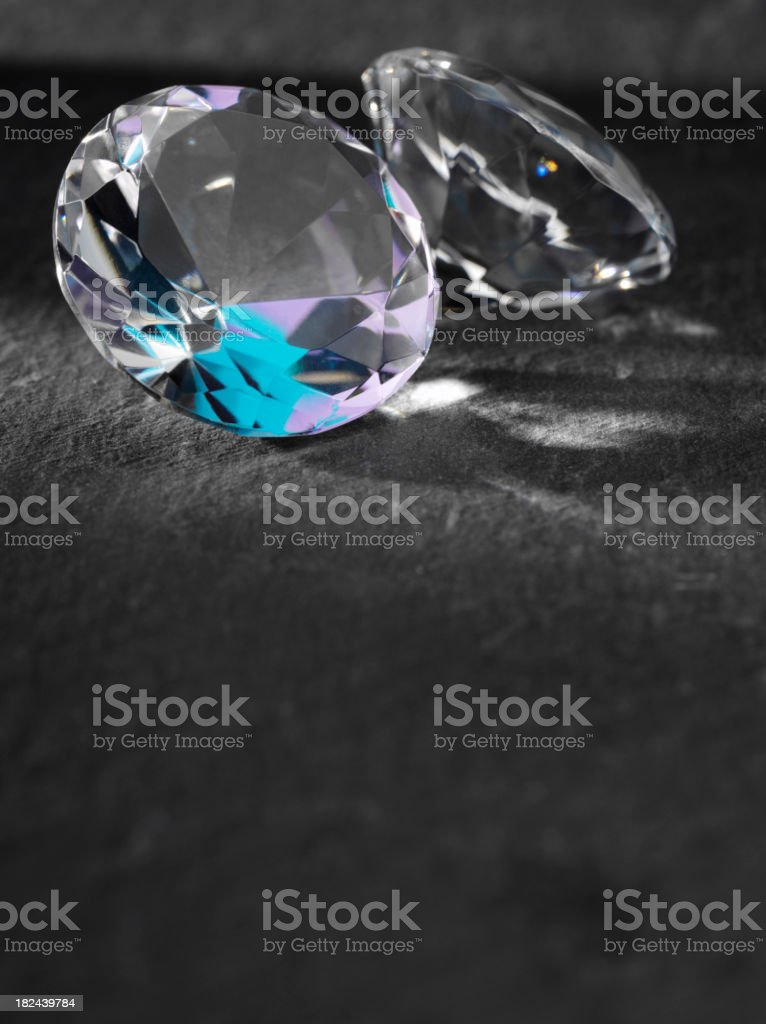 Two Faceted Diamonds with Copy Space royalty-free stock photo