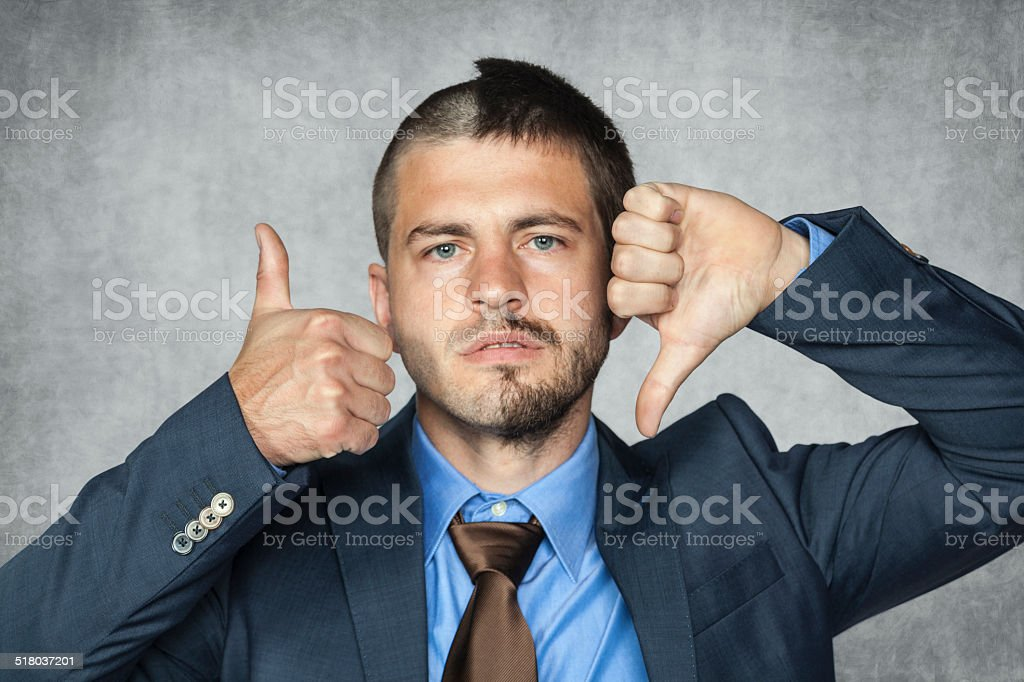 two facial businessman can not decide stock photo