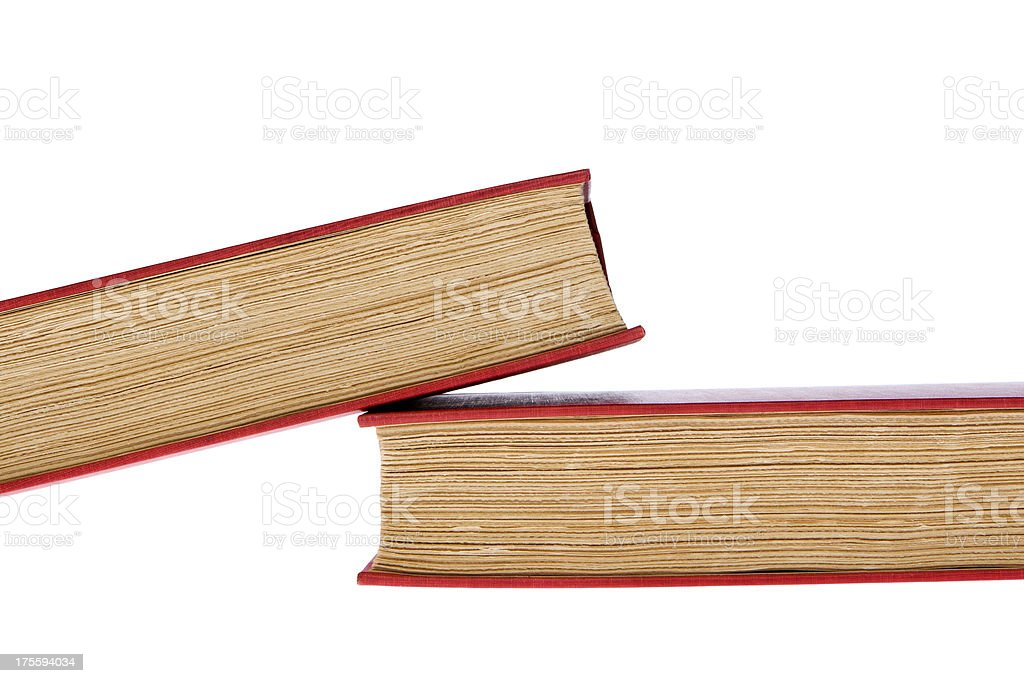 Two fallen old red hardcover books with roughly trimmed pages royalty-free stock photo