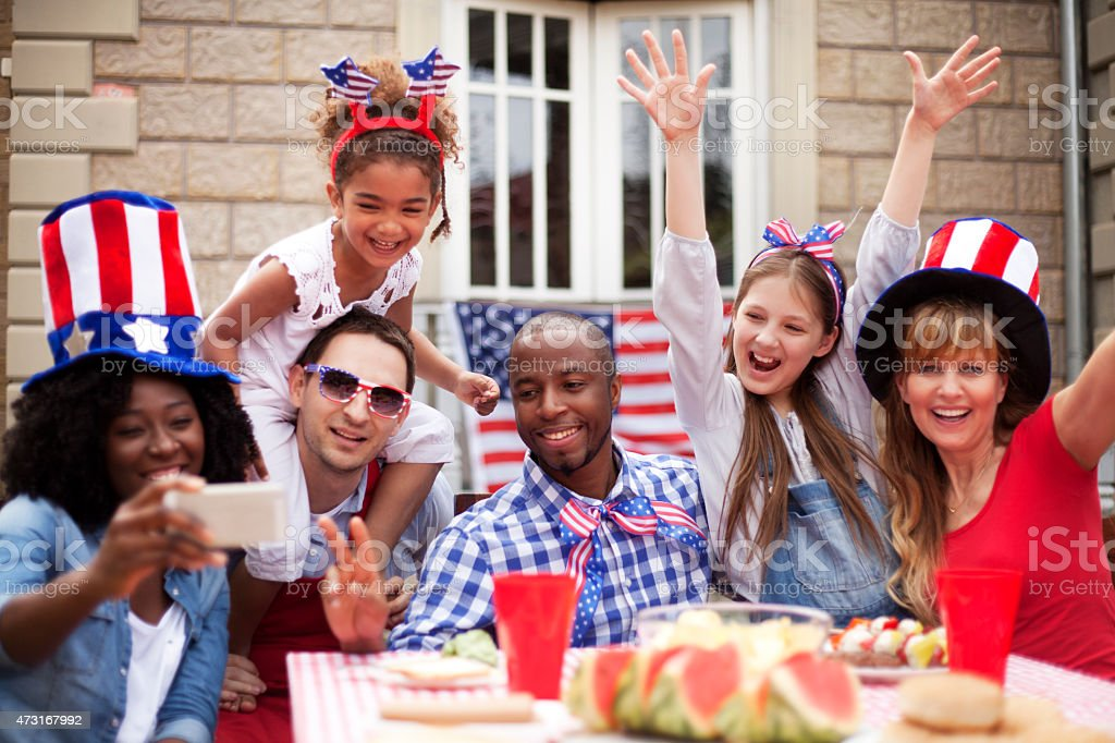 Two families happily celebrating Independence Day stock photo