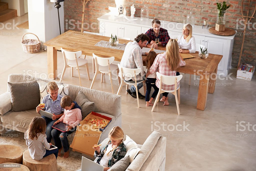 Two families spending time together at home stock photo