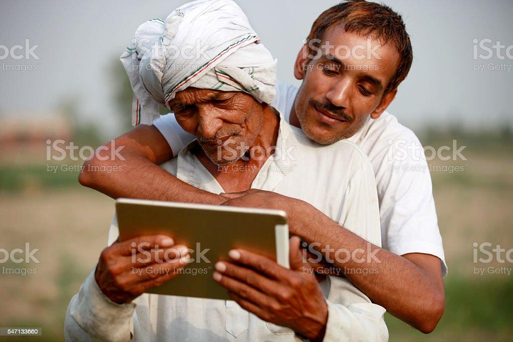 Two farmer using ipad stock photo
