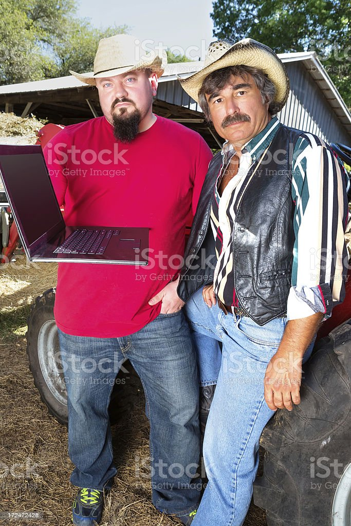 Two Farmers and a computer royalty-free stock photo