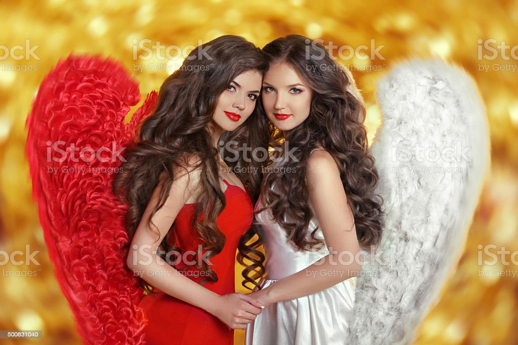 Two Fashion Beautiful Angels Girls models with curly long hair stock photo
