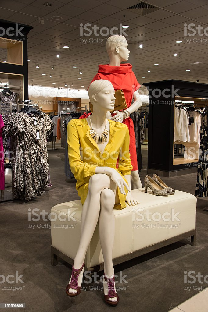 Two fashion mannequins dressed up in a clothing store. stock photo