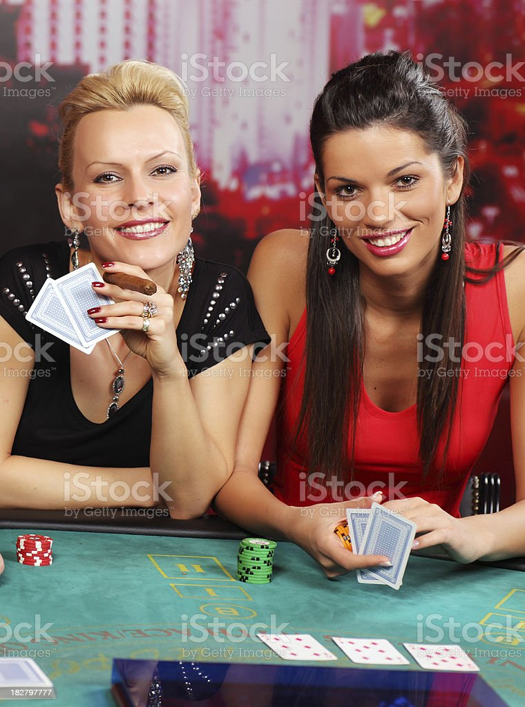 Two fashionable lady's having fun at casino. stock photo