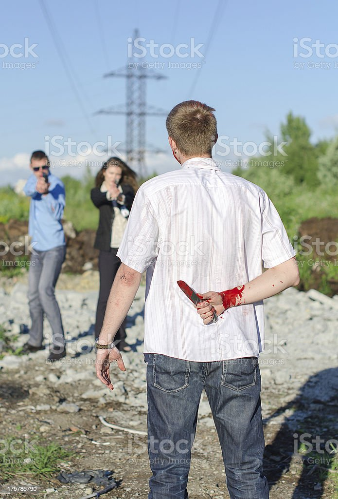 Two FBI agents arresting an offender with knife royalty-free stock photo