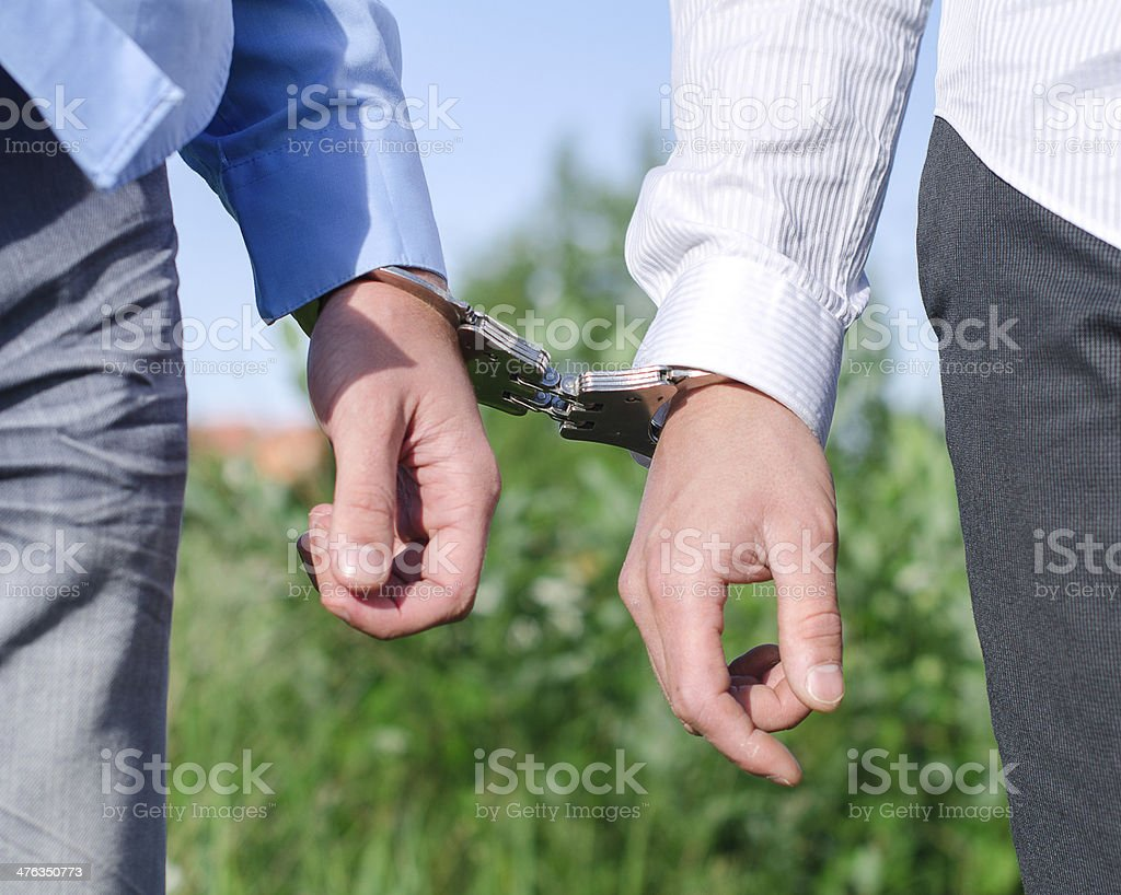 Two FBI agents conduct arrest of an offender royalty-free stock photo