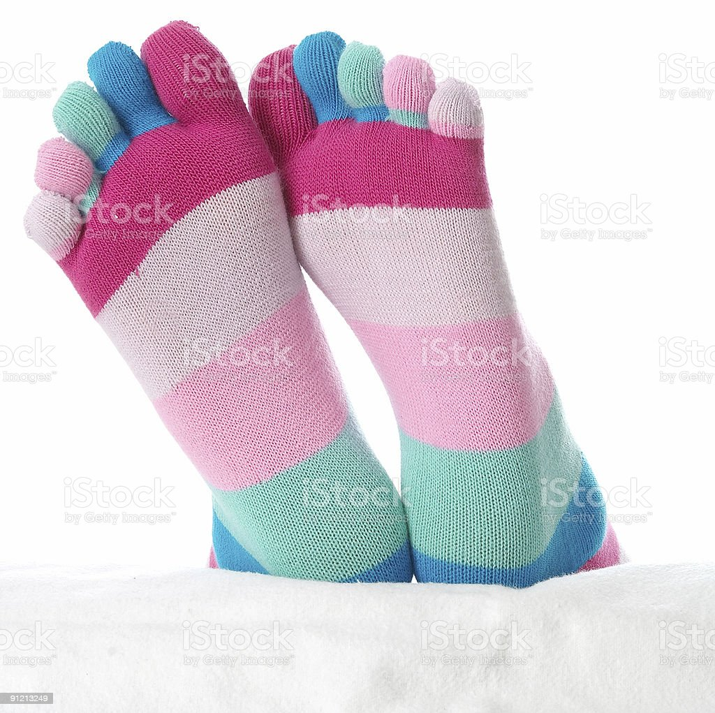Two feet in stockings royalty-free stock photo