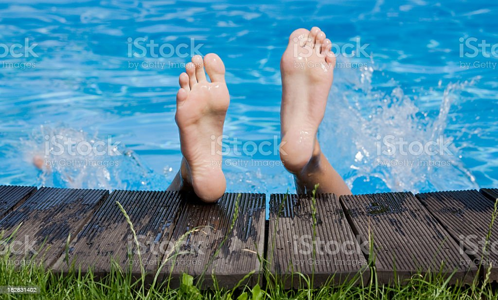 Two feet out of the water in a pool royalty-free stock photo