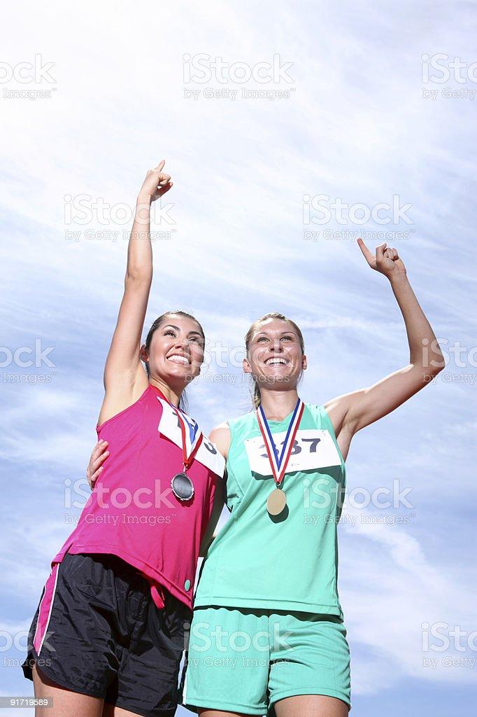 Two female athletes celebrating victory royalty-free stock photo