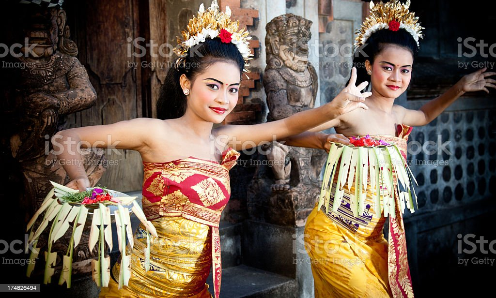 Two female Balinese dancers in their traditional costumes stock photo