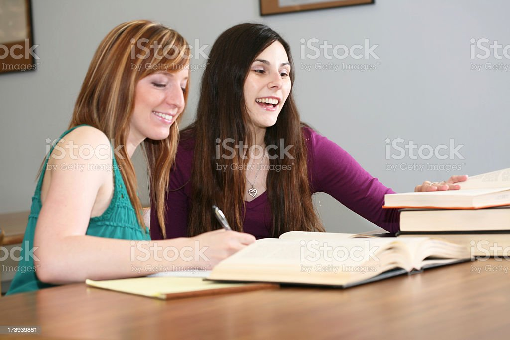Two Female College Students Doing Research Together at the Library royalty-free stock photo