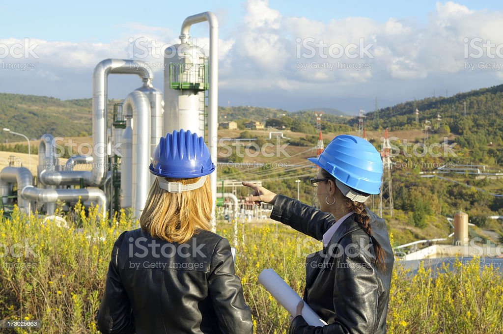 Two Female Engineers Planning in a Geothermal Power Station royalty-free stock photo