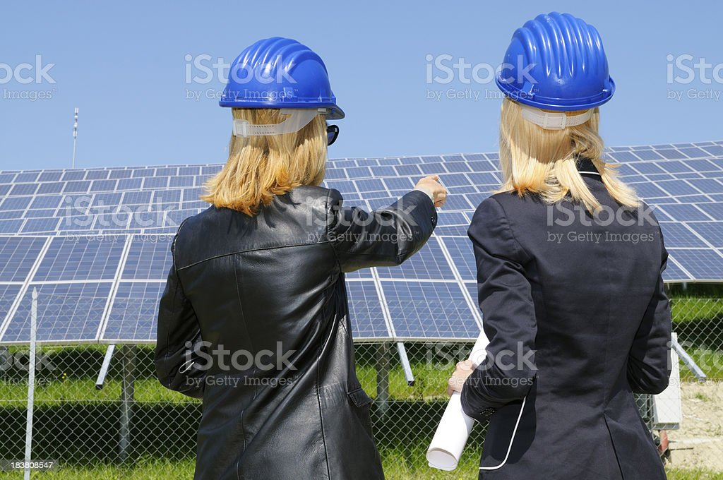 Two Female Engineers Planning in a Solar Power Station royalty-free stock photo