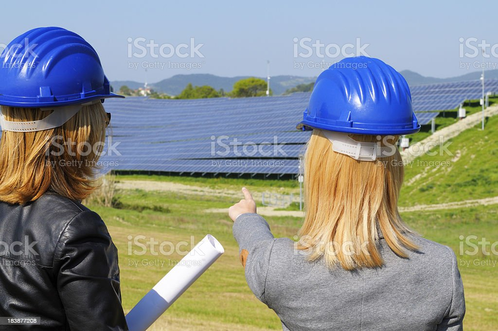 Two Female Engineers Planning in Solar Power Station royalty-free stock photo