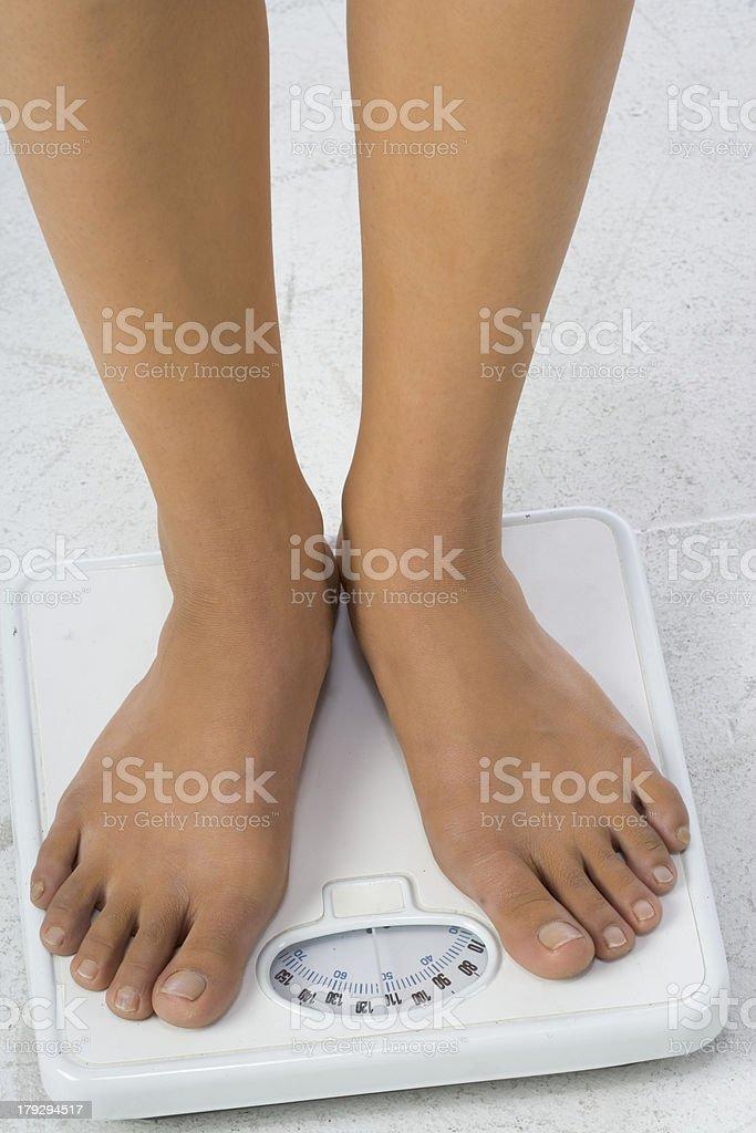 Two female feet on a bathroom scale stock photo