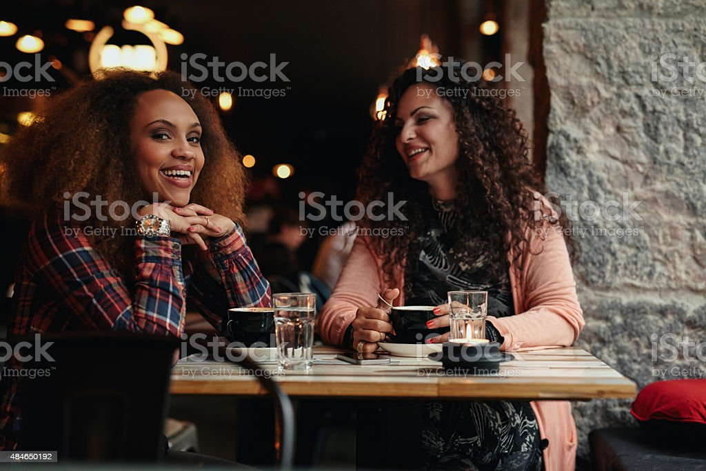 Two female friends at cafe stock photo